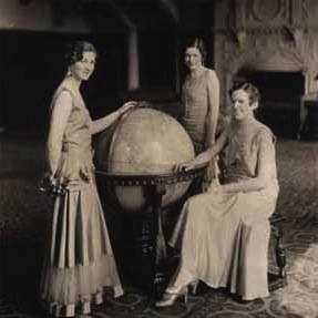 Three women around a globe